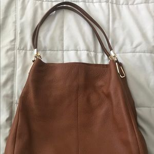 Used but in great condition nice size purse.